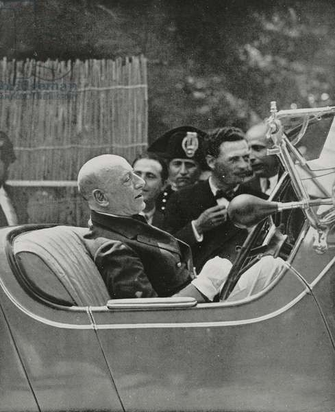 Italian poet Gabriele D'Annunzio (1863-1938) enters motorboat club on car, Gardone Riviera, Italy, from L'Illustrazione Italiana, year LVIII, n 21, May 24, 1931
