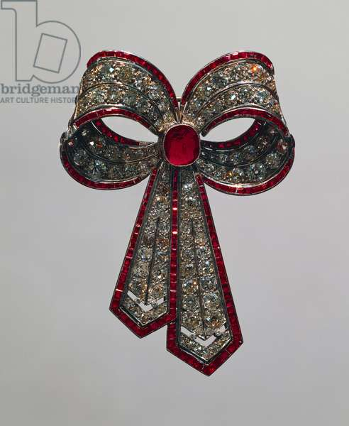 Bow knot brooch set with rubies and diamonds, 1920-1930