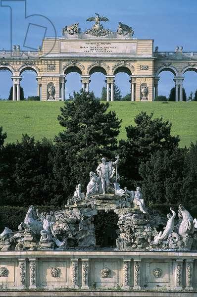 Statues on a fountain with archs in the background in a garden, Schonbrunn Palace Garden, Schonbrunn Palace, Vienna, Austria