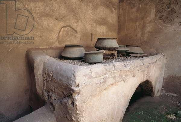Stonework fireplace in kitchen of Villa dei Vettii, Roman archaeological site of Pompeii (UNESCO World Heritage Site, 1997), Campania, Italy, 2nd-1st century BC