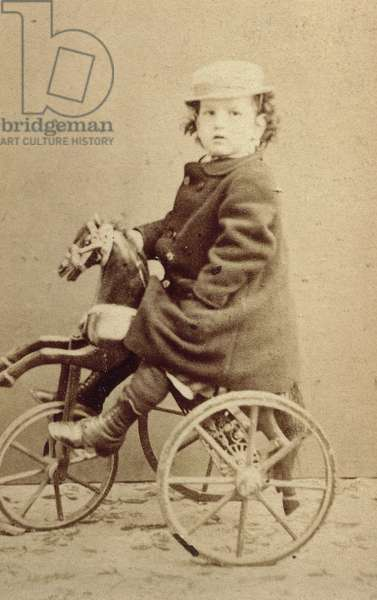 Claude Debussy (Saint-Germain-en-Laye, 1862-Paris, 1918), French composer and pianist, seen here as child on tricycle, April 15, 1867