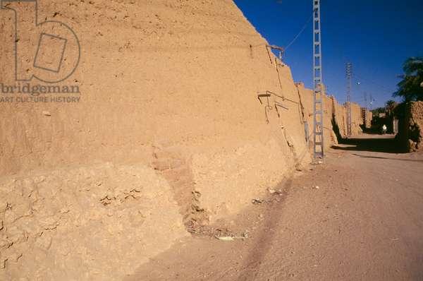 Street next to the dried mud walls, Adrar, Algeria