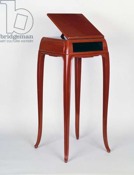 Reading table, by Jean Dunand (1877-942), lacquered in red, Art deco style. France, 20th century.