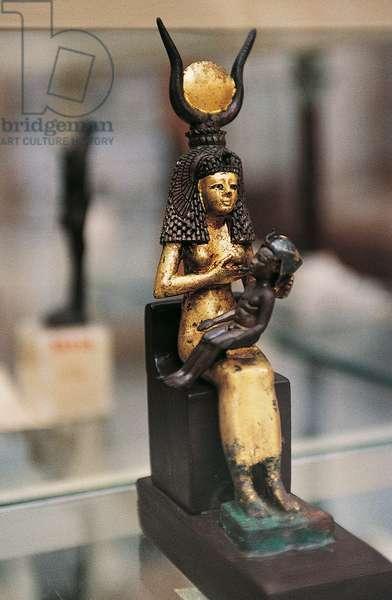 Gilded wood statuette of Isis breastfeeding infant Horus, From the Treasure of Tutankhamun, Egyptian civilization, New Kingdom, XVIII Dynasty
