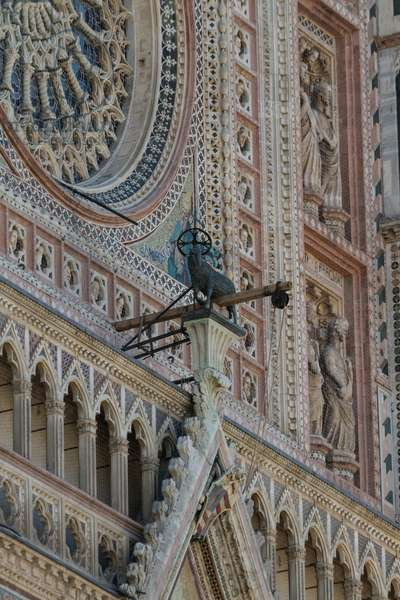 Agnus dei, by Matteo di Ugolino da Bologna, 1352, top of central gable of entrance in facade of Orvieto cathedral, Umbria, Italy, 14th century