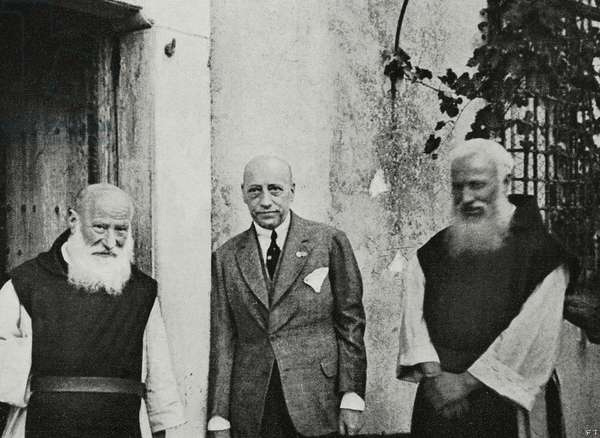 Italian poet Gabriele D'Annunzio with two Trappist monks at Maguzzano abbey, Lombardy, Italy, from L'Illustrazione Italiana, Year XLIX, No 41, October 8, 1922