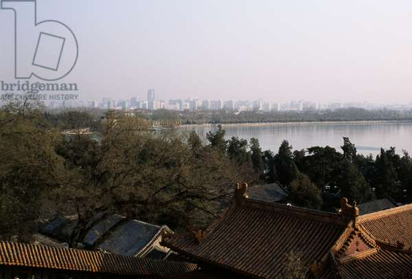 Roof of  pavilion of Summer palace (Unesco World Heritage List, 1998), with Kunming lake and modern skyscrapers in  background, Beijing, China, 19th century (photo)