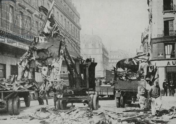 Removal of remains of British Handley Page Halifax bomber which crashed in centre of Paris, France, World War II, photograph by Hoffmann from L'Illustrazione Italiana, Year LXX, No 42, October 17, 1943