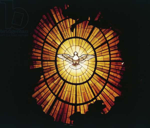 The dove of Holy Spirit depicted in stained glass window behind altar, Basilica of St Peter (16th century) (UNESCO World Heritage Site, 1980, 1990), Vatican City, Rome, Italy