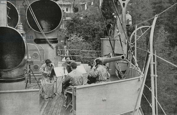 Vittoriale Quartet, string ensemble, plays on  prow of  ship named Puglia, set within  private garden of  poet Gabriele D'Annunzio (1863-1938), photo by Bruni, from L'Illustrazione Italiana, year LVII, n 20, May 18, 1930