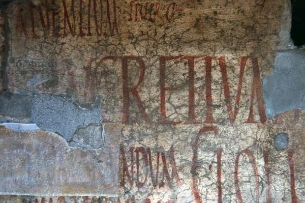 Electoral propaganda inscription on a wall of Via dell'Abbondanza, lower decumanus of Pompeii (UNESCO World Heritage List, 1997), Campania, Italy. Roman civilization, 1st century AD