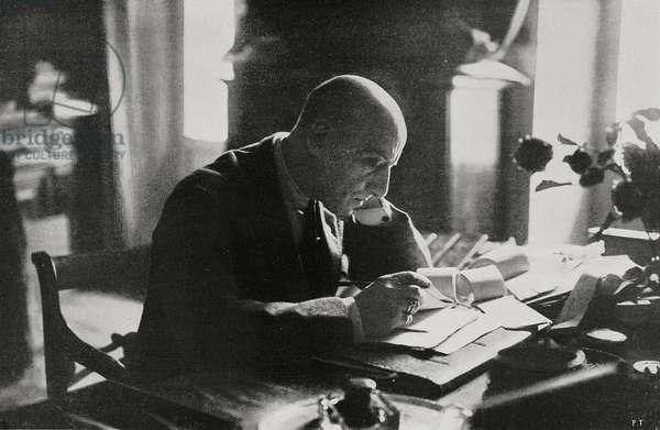 Italian poet Gabriele D'Annunzio in study at his Vittoriale degli Italiani estate, Gardone Riviera, Italy, from L'Illustrazione Italiana, Year XLVIII, No 47, November 20, 1922