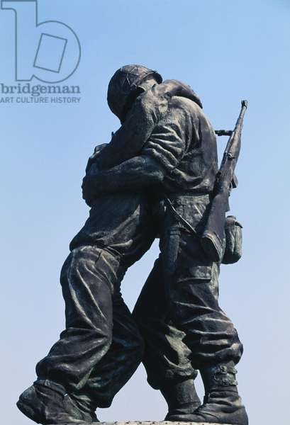 Statue of two brothers, depicting a South Korean soldier holding a wounded North Korean soldier, War Memorial, Seoul, South Korea