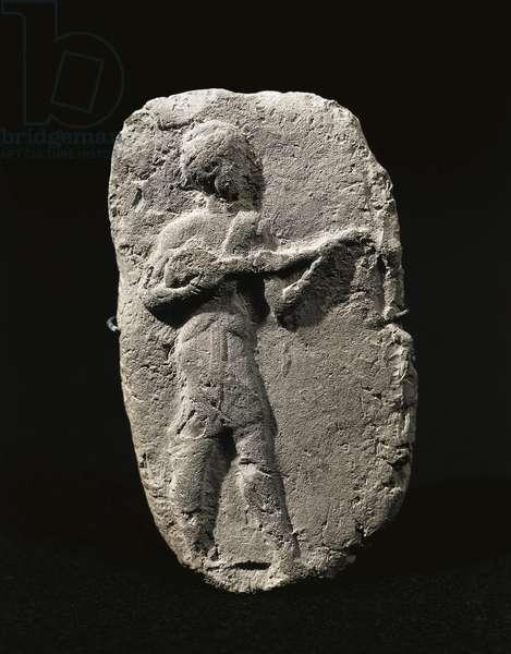 Terracotta relief depicting musician Artefact from Larsa, Iraq