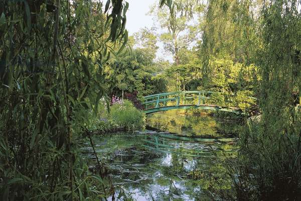 Wooden bridge over the lily pond in the garden of the house of Claude Monet (1840-1926), Giverny, Haute-Normandie, France
