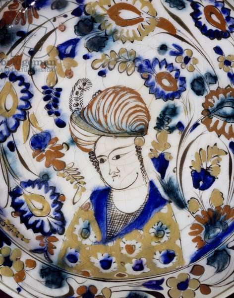 Plate decorated with figure of young man wearing turban, ceramic, Detail, Persia, 17th century