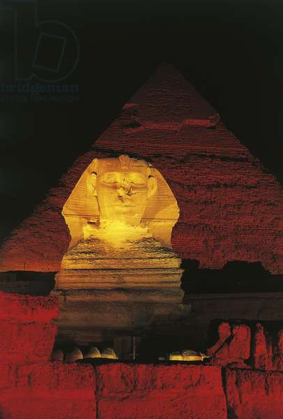 Great Sphinx and Chefren pyramid behind at night
