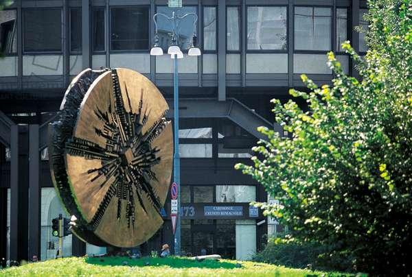 Il Disco (Disk), 1980, sculpture by Arnaldo Pomodoro (1926-), Filippo Meda Square, Milan, Lombardy, Italy, 20th century.