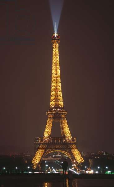 The Eiffel Tower illuminated at night, seen from the Trocadero, Paris (Unesco World Heritage List, 1991), France