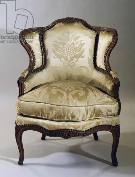 Louis XV style oak Bergere (with ears) upholstered in beige damask, France, 18th century