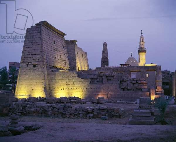 Egypt - Ancient Thebes (UNESCO World Heritage List, 1979). Luxor. Temple of Amon. Pylon of Ramses II, 1290-1224 BC. Evening lights