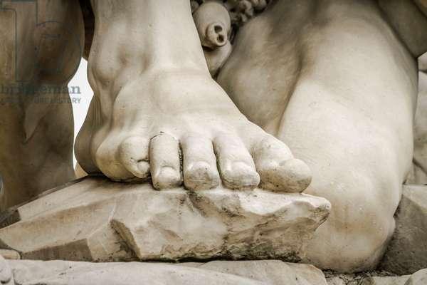 Foot, detail from Rape of Sabine women, 1583, statue by Giambologna (1529-1608), Loggia dei Lanzi, Piazza della Signoria, Florence (UNESCO World Heritage List, 1982), Tuscany, Italy