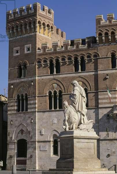 Monument to Canapone (Grand Duke Leopold II of Lorraine), 1846, in background Palazzo della Provincia or Aldobrandeschi Palace, 1903, Piazza Dante, Grosseto, Tuscany, Italy
