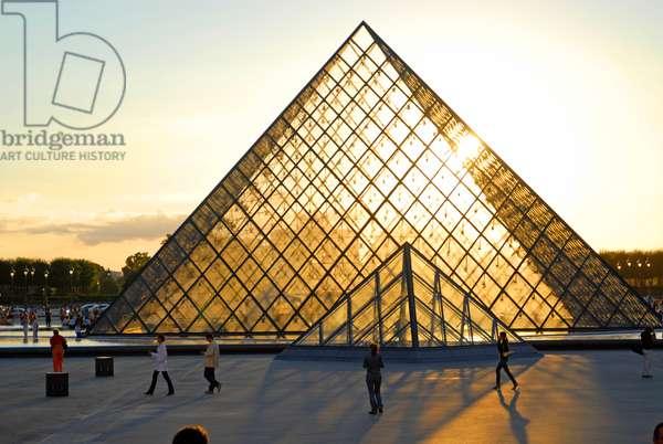 Louvre pyramid at sunset, Paris (Unesco World Heritage List, 1991), France