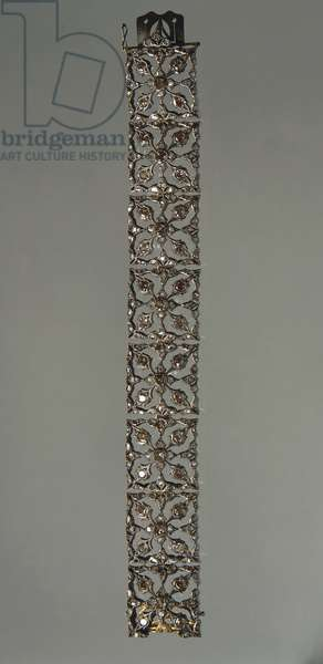 Openwork gold and silver band bracelet set with rose-cut diamonds, by Mario Buccellati, 1920s.