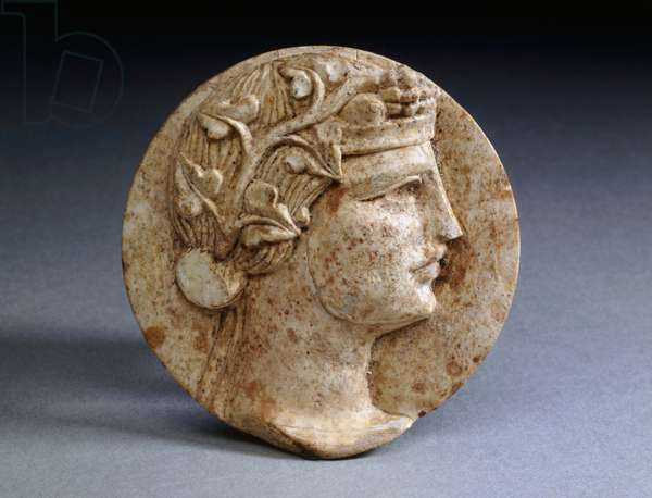 Circular wall sconce in bone depicting profile of maenad with her hair tied up with head band and her head crowned with ivy, Pompeii, Campania, Italy, Roman civilization, 1st century AD