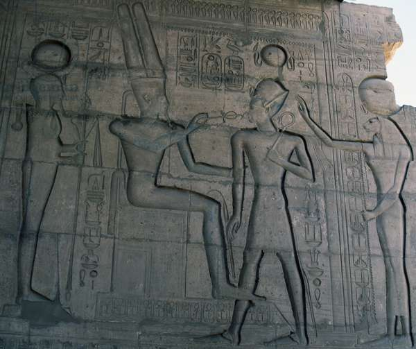 Amon opening Ramesses II's mouth accompanied by Sekhmet, relief, Great Hypostyle Hall of Ramesseum, Mortuary Temple of Ramses II, Deir el-Bahri, Thebes (Unesco World Heritage List, 1979). Egyptian civilization, Middle Kingdom, Dynasty XIX
