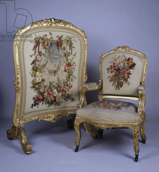 Louis XV style carved and gilt armchair and firescreen. France, 18th century