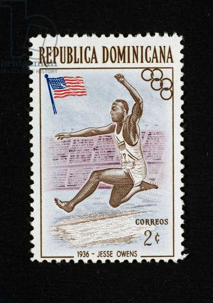 Postage stamp from series honoring Historical Olympic winners, 1957, depicting Jessie Owens doing long jump at 1936 Berlin Olympics, Dominican Republic, 20th century
