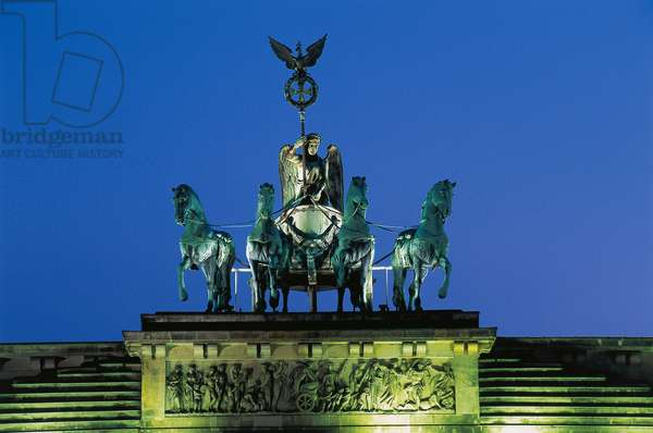 Night view of Quadriga, by Johann Gottfried Schadow (1764-1850), on top of Brandenburg Gate (Brandenburger Tor), Berlin, Germany, Night view