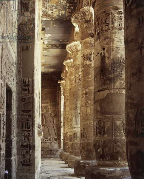Egypt, Ancient Thebes, Medinet Habu, Temple of Ramses III, first courtyard, south porch, columns with capitals in the form of open papyrus flower and reliefs