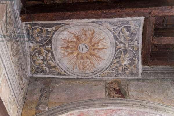 IHS monogram, medieval fresco in porticos of Treviso, Veneto, Italy