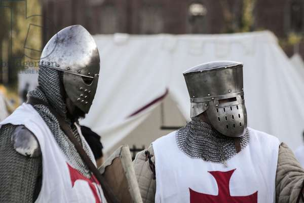 Historical reenactment: Crusader soldiers wearing helmets and chain mail, Crusades, 13th century