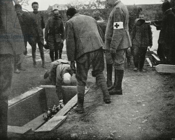Gabriele D'Annunzio (1863-1938) putting flowers on Giovanni Randaccio's (1884-1917) coffin, Italy, World War I, from L'Illustrazione Italiana, Year XLIV, No 24, June 17, 1917