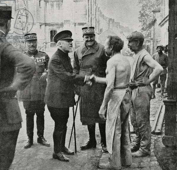 Georges Clemenceau (1841-1929), French Prime Minister, congratulating some French bakers who remained in Chateau-Thierry during German occupation, photograph from magazine L'Illustration, year 76, no 3935, August 3, 1918