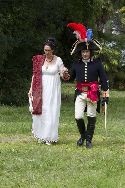 Historical reenactment: Napoleon Bonaparte (1769-1821) and his wife Josephine de Beauharnais (1763-1814) in the gardens of Villa Borromeo, Isola Bella (Lago Maggiore) in 1797. Napoleonic Wars, 18th century