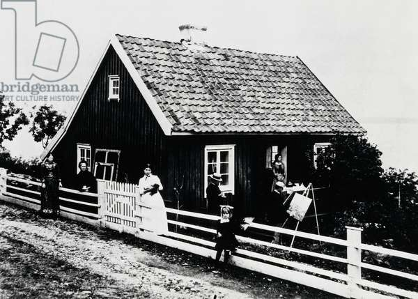 Edvard Munch (1863-1944), portrayed while painting, with his family at his house in Asgardstrand, Norway, photograph, 19th century
