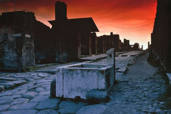 Sunset view of via dell'Abbondanza (Street of Abundance), lower decuman of Pompeii (UNESCO World Heritage Site, 1997), Campania, Italy, Roman civilization, 1st century