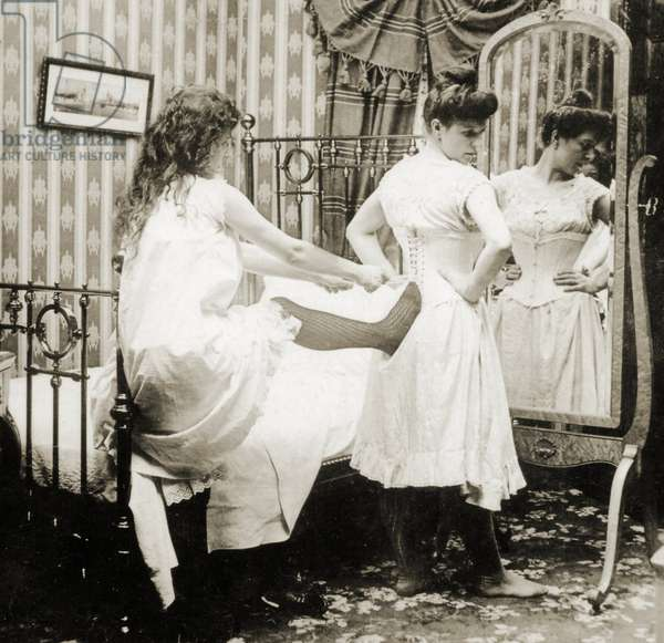 Humorous stereoscopic card depicting a woman being laced into a corset, c.1900 (sepia photo) (see also 473241)