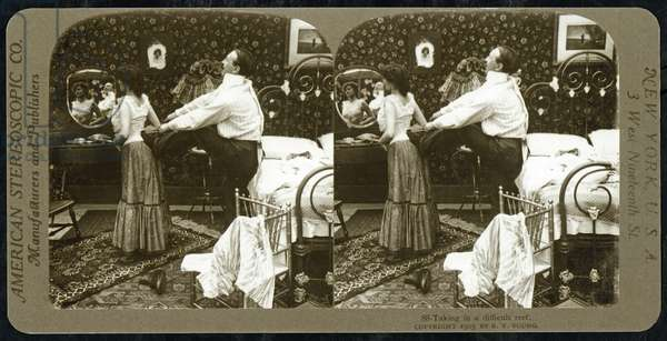 Stereoscopic card depicting a woman being laced into a corset, published by the American Stereoscopic Company,  1903 (sepia photo) (see also 473254)