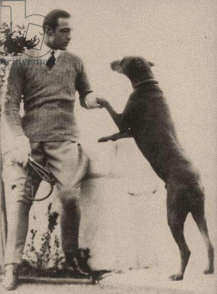 Portrait of Rudolph Valentino (1895 – 1926) and his doberman Kabar (b/w photo).