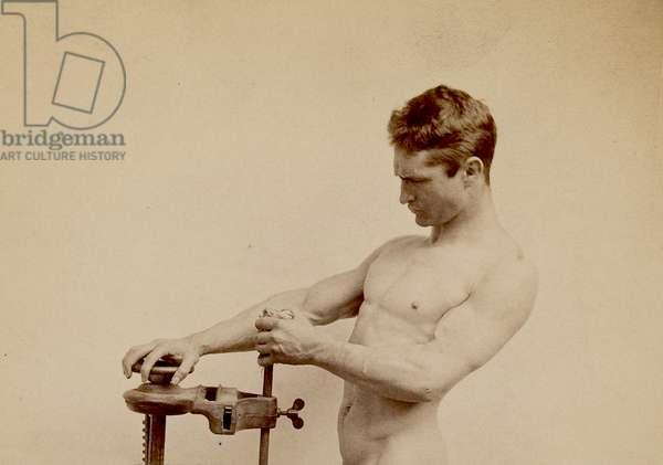 Portrait of Bernarr Macfadden weighing himself, 1893 (photo)
