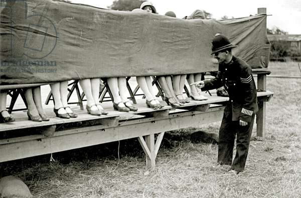 Policeman judges a Lovely legs competition, c.1924 (b/w photo)