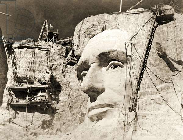 The construction of The Mount Rushmore National Memorial, detail of Abraham Lincoln,1928 (sepia Photo)