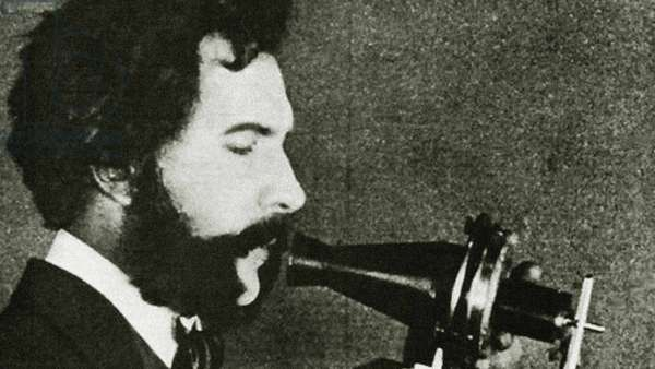 Portrait of Alexander Graham Bell speaking into a telephone receiver, c.1876 (photo)