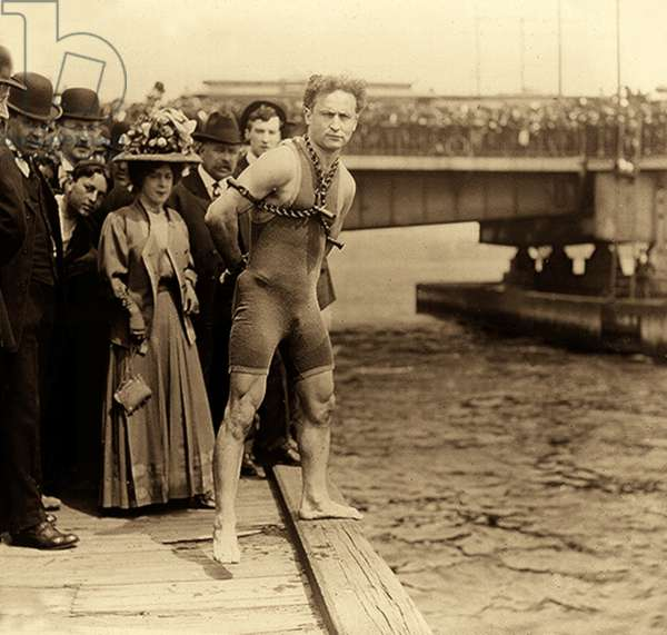 Harry Houdini in chains, New York Harbour, c.1912(sepia photo)